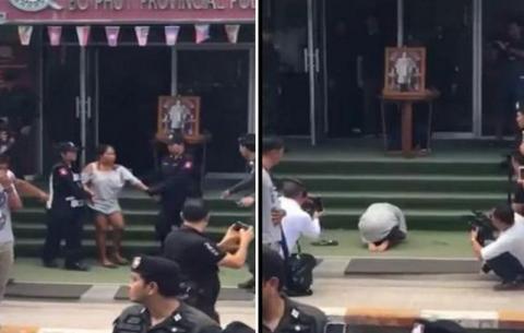 فيديو - شرطة تايلاند تهين امرأة وتجبرها على السجود لصورة الملك الراحل