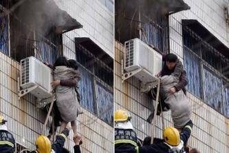 مشلول يتسلق مبنى محترق لإنقاذ امرأة
