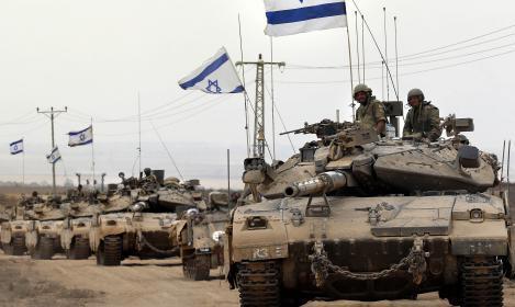 هآرتس: نشر الجيش صوراً لآلياته على حدود غزة محاولة للردع