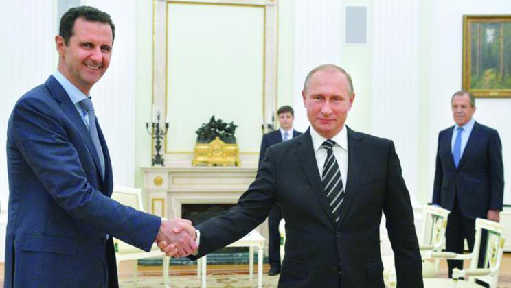 """شاهد.. تسريب صورة جديدة """"مذلة"""" لبشار الأسد مع بوتين"""