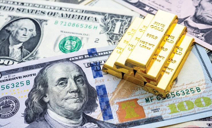 الدولار يتراجع والذهب يرتفع مع اقتراب بايدن من البيت الأبيض